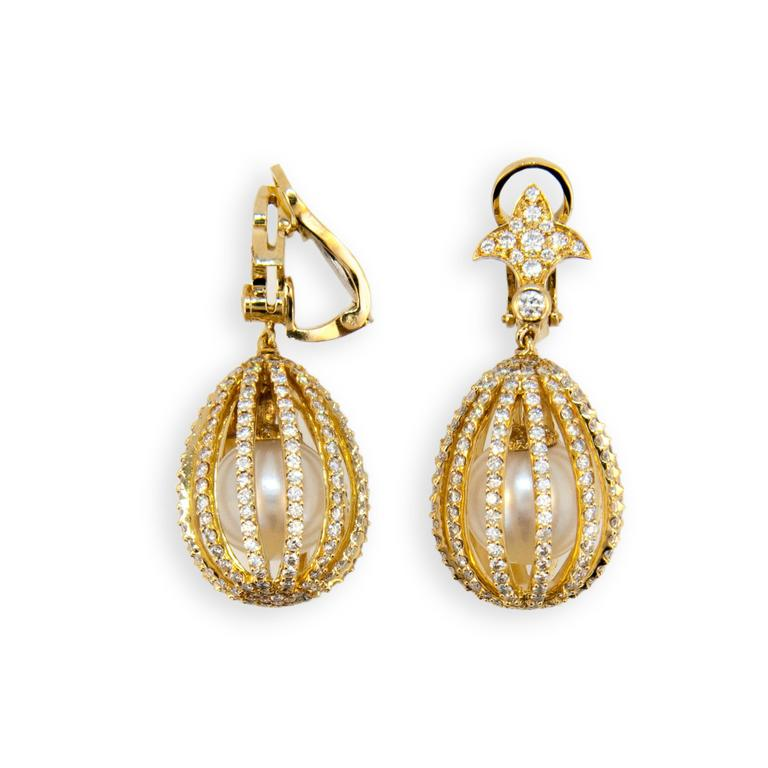 18 karat yellow gold Cage earrings set with 13 mm South Sea Pearls and 500 Diamonds 6.99 carats total weight