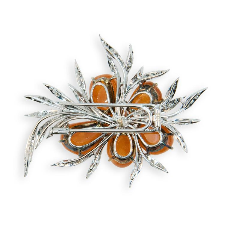 18K blackened yellow and white gold brooch with five cabachon Mandarin Garnets 70.57cts.twt and 141 round diamonds 3.32cts.twt