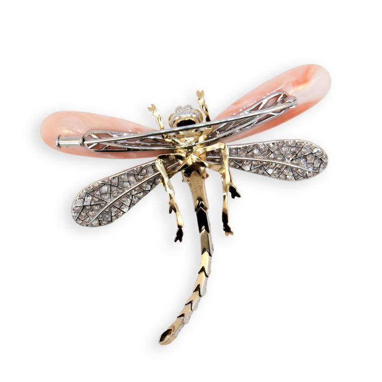 18 karat yellow and white gold Dragonfly brooch set with (2) approx. 6.80 gram total weight. Angel Skin Coral drops for front wings,back wings,body and tail set with 199 round Diamonds 2.38 carats total weight. Tip of tail is set with (1) Marquise