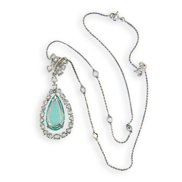 18 karat blackened white gold necklace set with one faceted pear shaped Mint Green Tourmaline 17.94 carats. Set above and around Tourmaline are 30 fancy shaped rose cut diamonds and six oval rose cut diamonds bezel set on chain. Total weight of 36