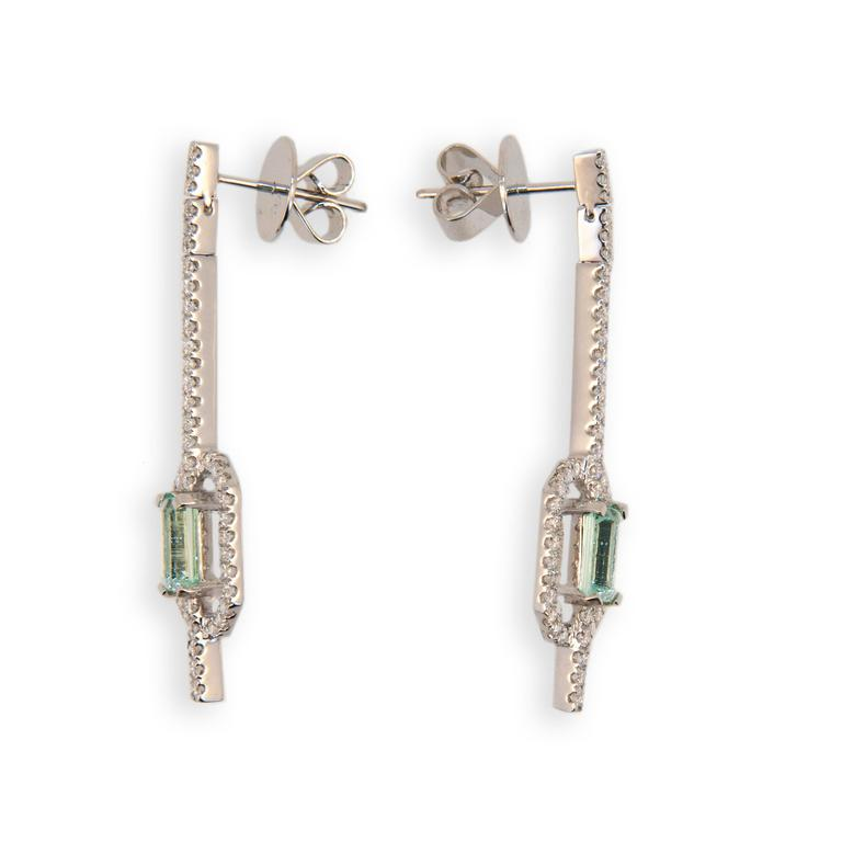 18 karat white gold earrings each set with one emerald cut Mint Green Tourmaline two are 1.58 carats total weight. Micro-set in a straight line from post and in an octagonal frame around Tourmaline are 47 Diamonds 94 total .93 carat total weight.