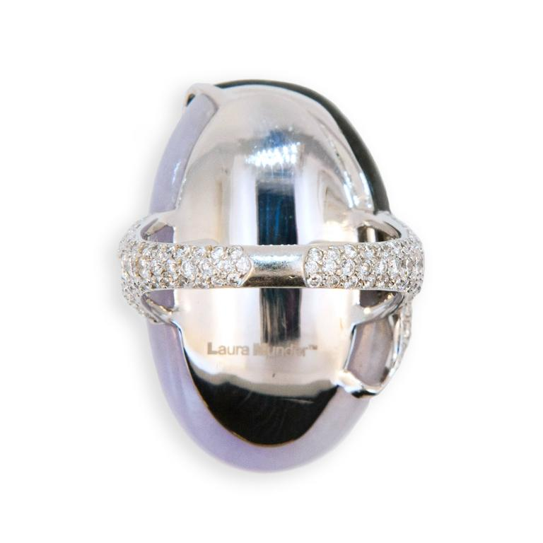 18 karat white gold ring oval curved Lavender and Black Jade with raised flower and leaf design set with diamonds, shank is pave' set with diamonds 143 diamonds 2.10 carats total weight.  Size 7 plus with a horseshoe.