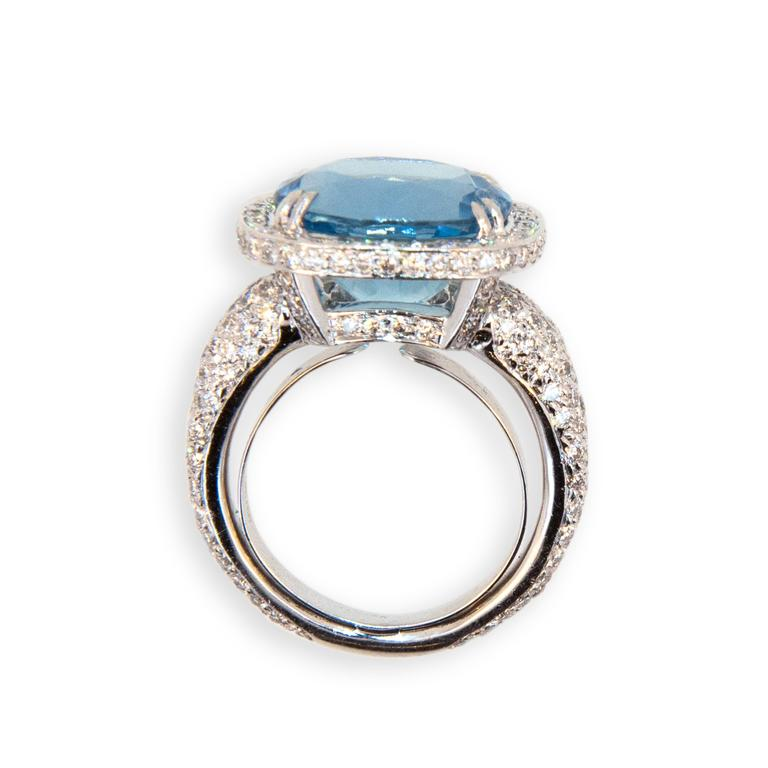 18 karat white gold ring set with Aquamarine 6.70 carats tota weight.  218 Round diamonds 1.93 carat total weight. Diamonds set on shank all the way around except on sizing bar at bottom. Diamonds also under bezel beneath aquamarine. Ring is a size