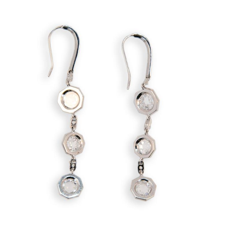 18 karat white gold drop earrings each with three octagonal sections each set with one octagonal rose cut diamond (6) have total weight of 2.54 carats surrounded by micro-set diamonds (96) total .48 carat total weight. Wire at top set with (13)