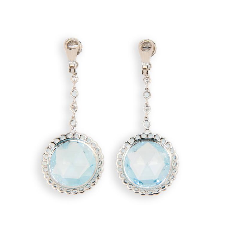 18 karat white gold Blue Topaz, diamond, and aquamarine earrings. Briolette topaz 45.00 carats, Diamonds .78 carat, aquamarine 3.30 carats.