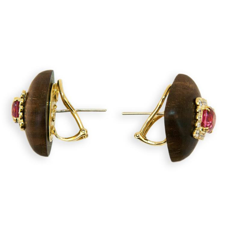 18 karat yellow gold earrings dark wood each set with one Pink Spinel cushion shaped oval (2) Spinel 3.33 carats total weight. Square frame each set with (16) Diamonds (32) Diamonds total .68 carat total weight. Posts and Clips.