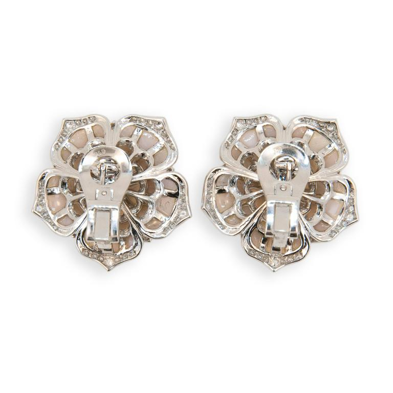 18 karat white gold flower shaped earrings set with (35) pieces of Pink Opal in each earring (70) total. Edges of petals are set with 150 round Diamonds .97 carat total weight and center of each flower is set with one Pink Spinel (2) 1.51 carats