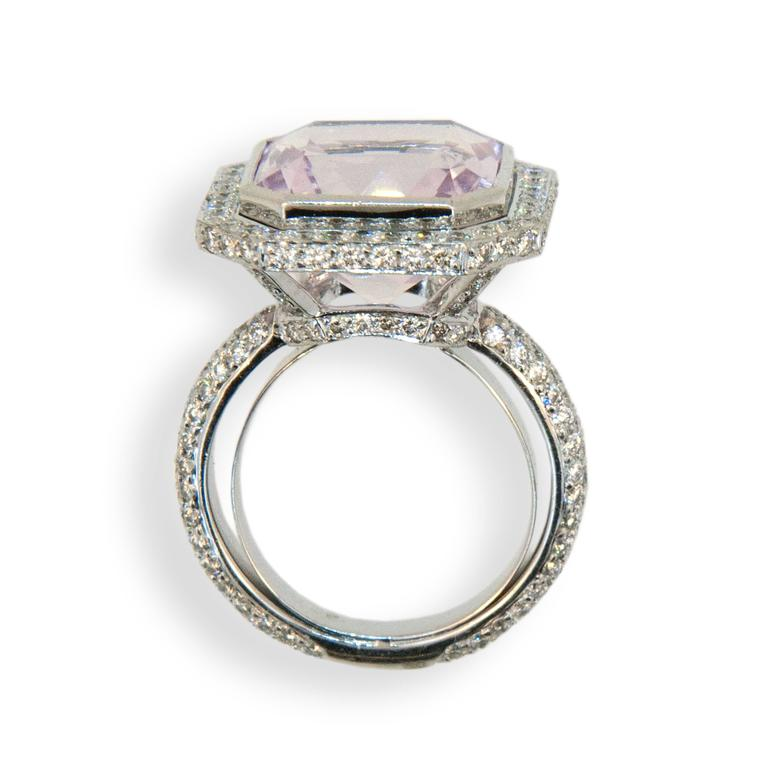 18 karat white gold ring set with an octagonal cut Kunzite 11.49 carats total weight 12.91 mm x 9.17 depth x 15.04 and micro-set with  206 round diamonds 1.97 carats total weight. Ring is a size 6.75 with a horseshoe.