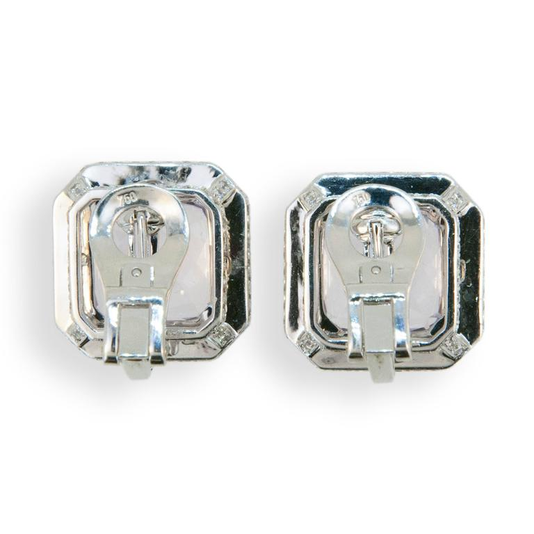 18 karat white gold earrings set with octagonal Kunzite 21.83 carats total weight and micro-set with 232 round diamonds 1.93 carats total weight. Earrings may be worn as clips or pierced, posts fold down.