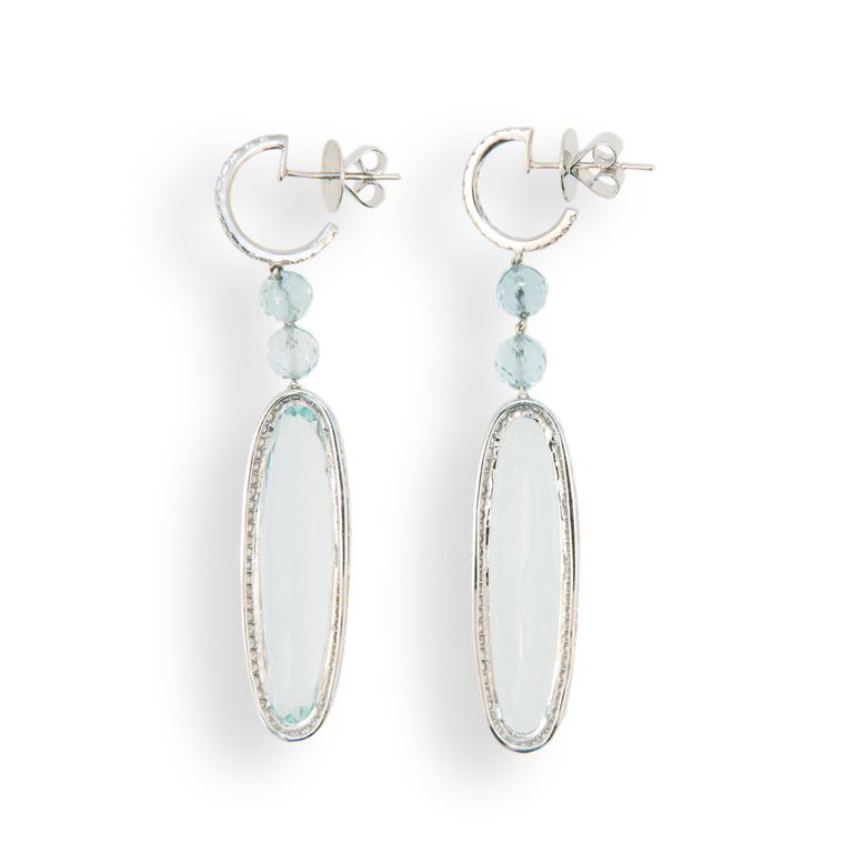 18 karat white gold drop earrings set with (2) long oval Aquamarines 34.18 carats total weight. Approximately 1 3/8 inches length, four faceted Aquamarine beads 5.36 carats total weight and 156 micro set round Diamonds 1.13 carats total weight. Top