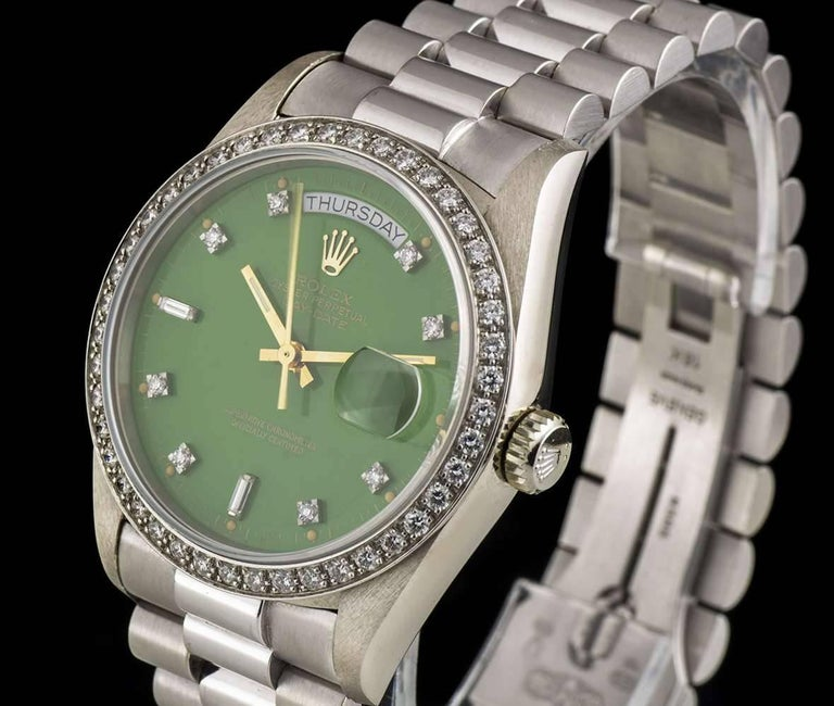 A Very Rare White Gold Oyster Perpetual Day-Date Gents Wristwatch, original green Stella dial with 10 applied round brilliant cut diamond and 2 baguette cut diamond hour markers, day at 12 0'clock, date at 3 0'clock, an white gold fixed bezel set