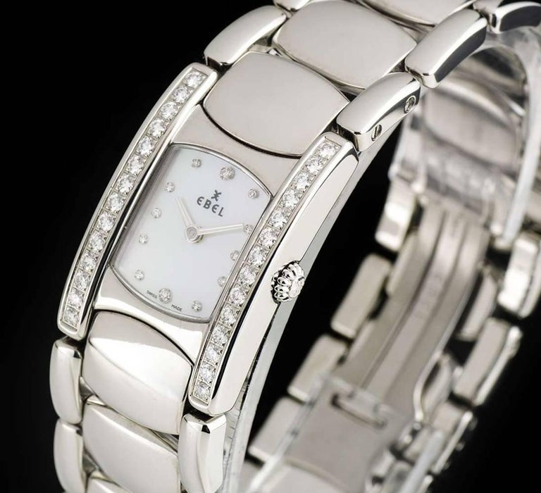 A Stainless Steel Beluga Manchette Ladies Wristwatch, mother of pearl dial with 12 applied round brilliant cut diamond hour markers, a fixed stainless steel bezel, a stainless steel case set with a single row of approximately 14 round brilliant cut