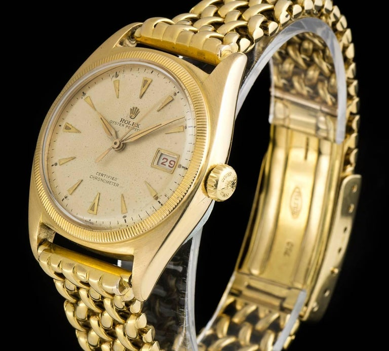 A Rare 18k Yellow Gold Semi Bubble Back Oyster Perpetual Vintage Gents Wristwatch, silvered dial with applied hour markers, a fixed 18k yellow gold coin edge bezel, a very rare original 18k yellow gold bracelet with an original 18k yellow gold