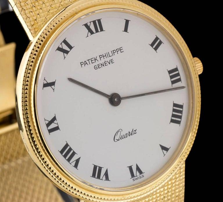 Patek Philippe White Enamel Dial Gold Quartz  Calatrava Wristwatch In Excellent Condition For Sale In London, GB