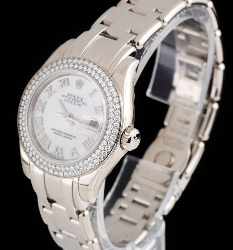 An Unworn 18k White Gold Oyster Perpetual Pearlmaster Datejust NOS Ladies Wristwatch, white mother of pearl dial with applied roman numerals, date a 3 0'clock, a fixed 18k white gold bezel set with approximately 116 round brilliant cut diamonds, an