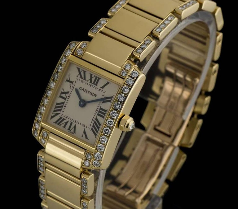 An 18k Yellow Gold Diamond Set Tank Francaise Ladies Wristwatch, silvered dial with roman numerals and a secret signature at