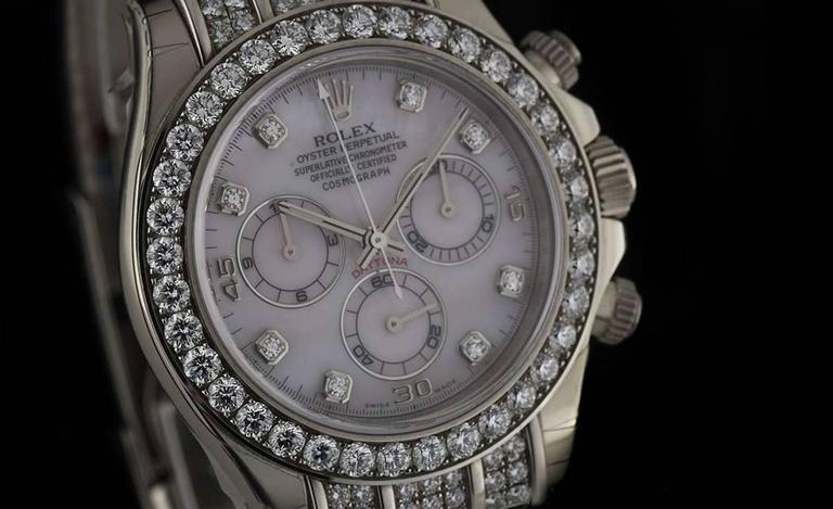 An Unworn 18k White Gold Oyster Perpetual Daytona Gents Wristwatch 116599RBR, pink mother of pearl (MOP) dial set with 8 applied round brilliant diamond hour markers and applied arabic quarterly numbers, 30 minute recorder at 3 0'clock, small