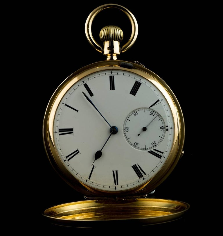 A Gold Vintage Full Hunter Pocket Watch, white enamel dial with roman numerals, small seconds at 6 0'clock, a fixed gold bezel and case, a gold inner cuvette case, plastic glass, exhibition caseback, 3/4 plate Karrusel lever movement, in excellent