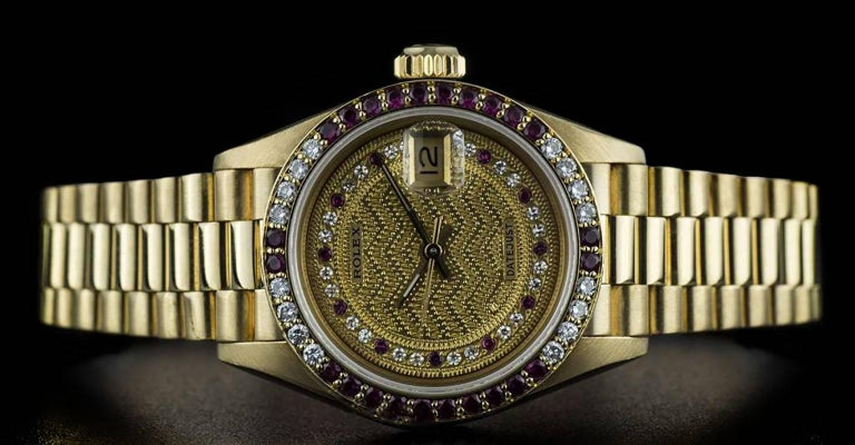 Women's Rolex Gold Rare String Dial Ruby and Diamond Datejust 69068 Automatic Wristwatch For Sale