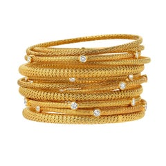 Group of 13 18k Gold and Diamond Bangles