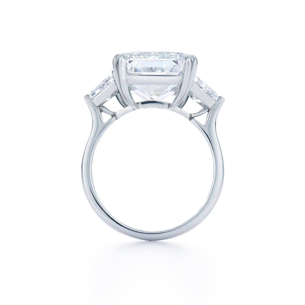 A beautiful 8.01ct, I color, VVS2 clarity Emerald Cut Diamond ring. This ring is set in platinum with two stunning trapezoid side stones, that weigh .75cts, and are HI in color and VS1 in clarity.