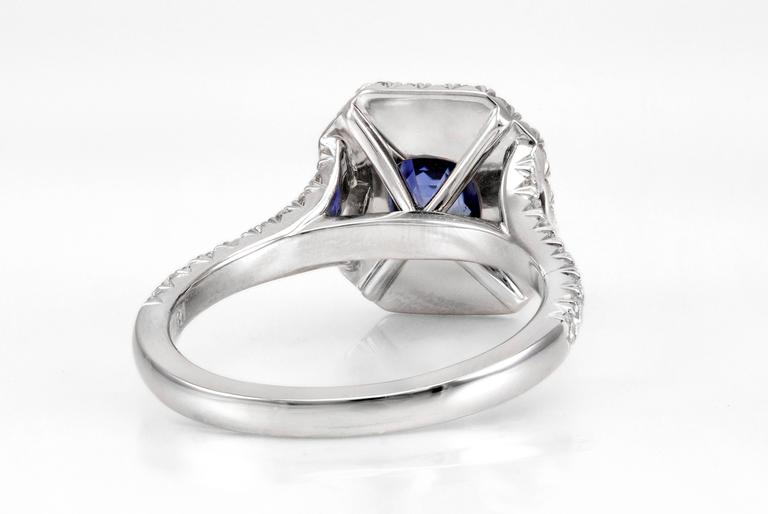 Radiant Cut 1.18 Carat Blue Sapphire and Diamond Halo Ring For Sale