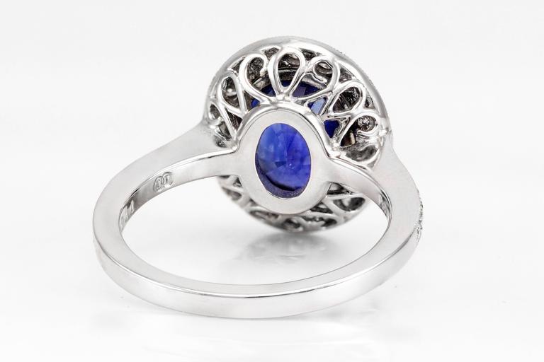 This ring features a 3.60 carat blue sapphire surrounded by a single row of brilliant round diamonds that continue to the shank of the ring. The diamonds weigh 0.53 carats total. The sapphire has a rich blue color and is eye clean. Set in platinum.