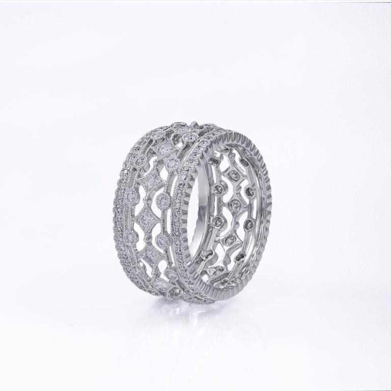 This band ring features an intricate fashionable design set with 152 round brilliant diamonds all around the ring. The diamonds weigh 1.04 carats total. Set in 18k white gold. Size 6 US.