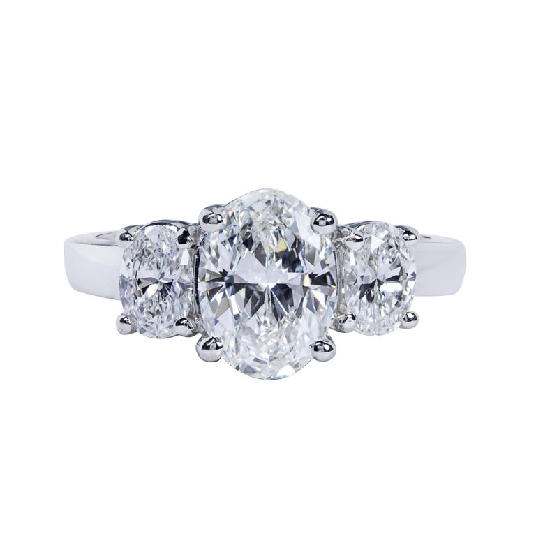 This ring features a 1.51 carat oval cut diamond center stone that GIA certified as J color and VS1 Clarity. The center diamond is flanked by 2 oval cut diamond side stones weighing 0.70 carats total. Made in platinum. Size 6 US (sizable upon