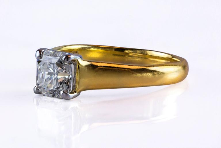 Center diamond 1.35ct F, VS1 GIA Certified with Excellent Polish & Symmetry and no fluorescence. The diamond set in 4-prong platinum & 18K yellow gold setting. Signed and numbered