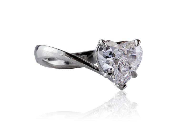 The ring features 2.00ct heart-shape diamond. The diamond is F color and SI2 clarity with certificate from Gemological Institute of America. The diamond set in platinum. Ring size 6 1/4 US (resizable).   Style available in different price ranges.