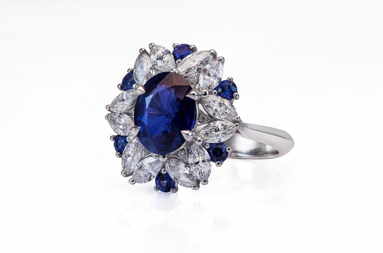 Features oval-shape natural sapphire weighing 2.45 carat total. The sapphire is certified by GRS (Switzerland) as natural with Sri-Lanka origin and no indications of heating. This sapphire displays intense vivid blue color and has a grading of
