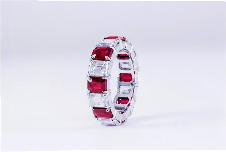 This all around wedding band features 8 emerald-cut natural rubies weighing 4.18 carat total and 8 emerald-cut diamonds weighing 4.09 carat total. The diamonds are H/VS quality. The ring is made in platinum.  Style available in different price