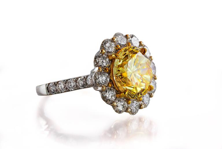 This ring features one very rare round brilliant diamond. This diamond is certified by GIA as Fancy Intense Yellow color and VVS2 clarity. The color of this intense yellow diamond is very strong and in real life appears to be close to vivid yellow.