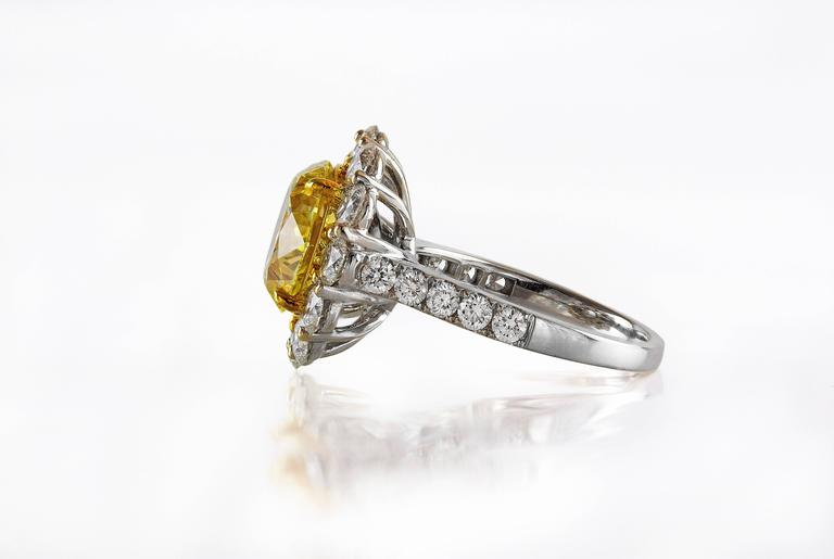 Round Cut GIA Certified 4.47 Carat Fancy Intense Yellow Diamond Ring For Sale