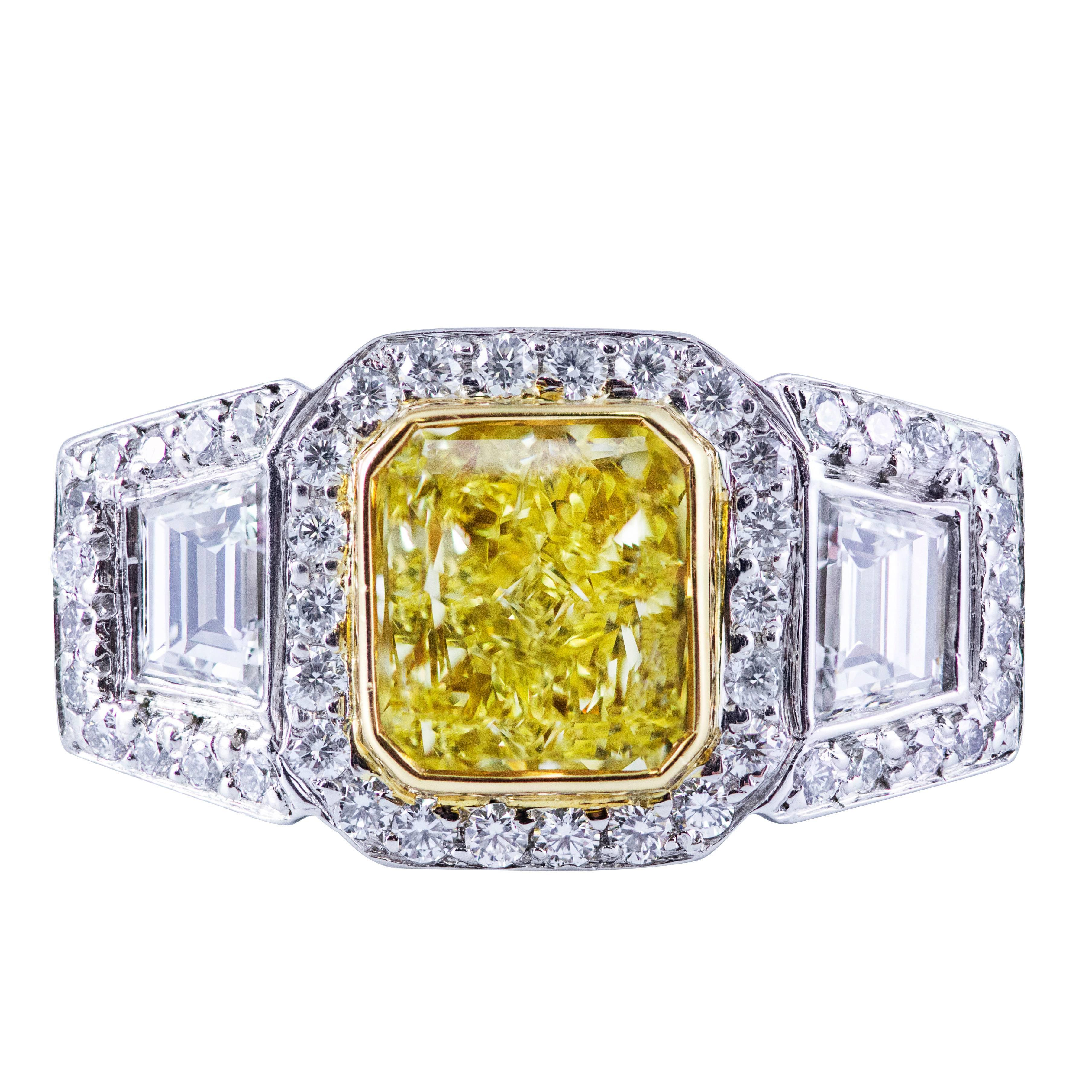 GIA Certified Fancy Intense Yellow Three-Stone Halo Engagement Ring