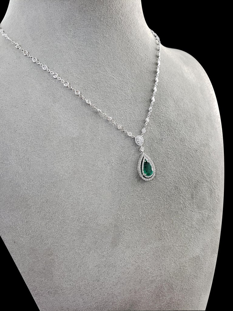 Contemporary Green Emerald and Diamond Double Halo Drop Necklace For Sale