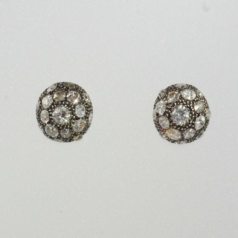 Victorian 18K rose gold over silver, diamond earrings, domed shape, set with 34 European round diamonds weighing about 9.50 carats total.