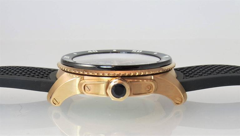 Brand new, never worn, 18K rose gold Cartier Calibre Diver watch, automatic movement, date function, 42mm case,  unidirectional turning bezel, black dial, rubber strap with ardillion buckle.  Retails for $27300 Brand new, 2 year warranty