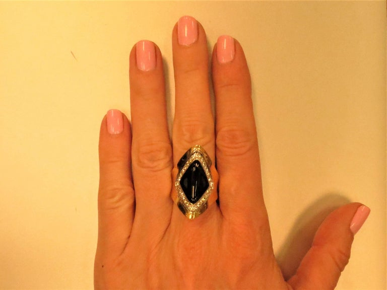 18K yellow gold black onyx ring set with 24 full cut round diamonds weighing .50cts, VS-SI clarity. Finger size 6. May be sized.