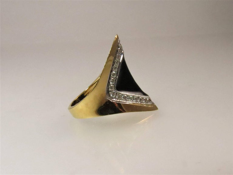 Contemporary 18 Karat Yellow Gold Diamond and Black Onyx Ring For Sale