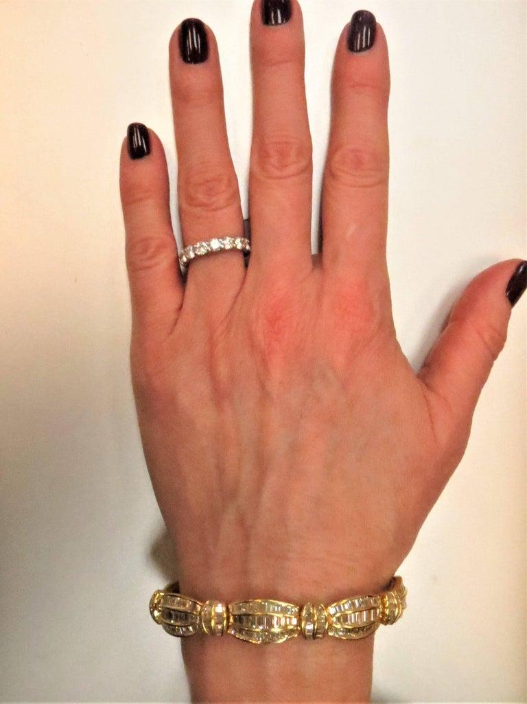 Unique Picchiotti 18K yellow gold bracelet, set with 315 baguette diamonds weighing 16.82cts, channel set, F-G color, VS clarity
