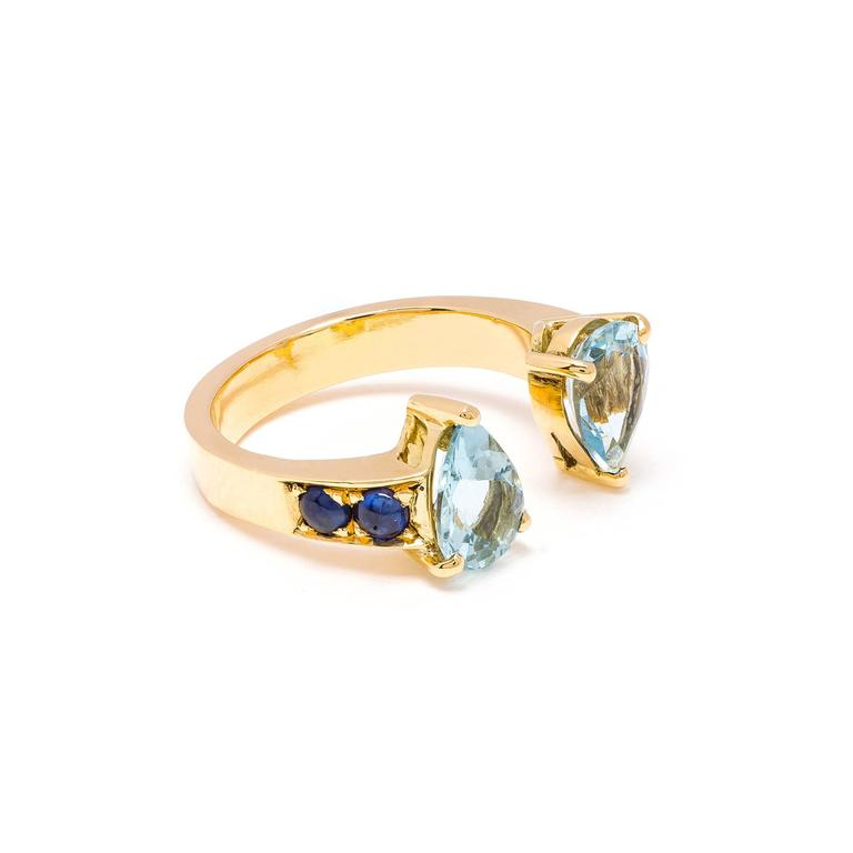 This DUBINI ring from the 'Theodora' collection features aquamarine drops with blue sapphire cabochons set in 18K yellow gold.   Ring sizes available: 52 (US 6)  The ring may be ordered in any size with a lead time of 3-4 weeks.  Please note that we