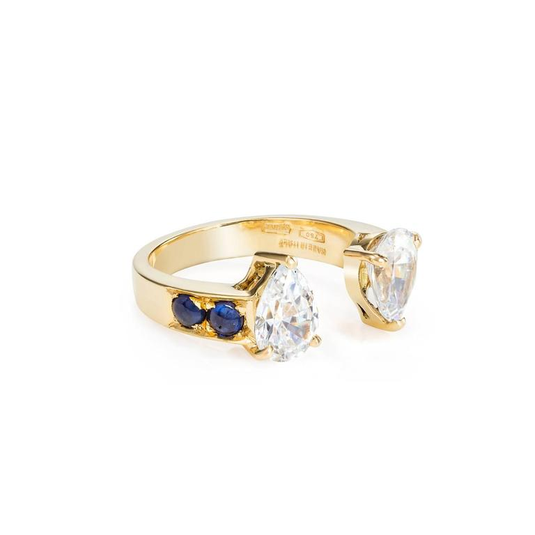 This DUBINI ring from the 'Theodora' collection features white topaz drops with sapphire cabochons set in 18K yellow gold.   This ring may be ordered in any size with a lead time of 3-4 weeks.  Diamonds can be used instead of White Zircon - PRICE