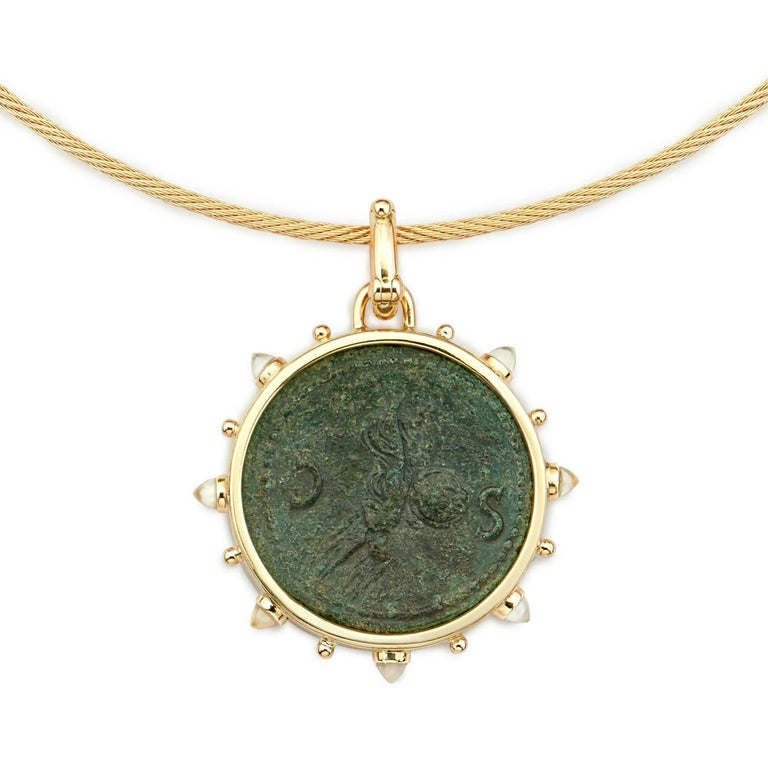 This DUBINI coin necklace from the 'Empires' collection features authentic bronze roman coin of Nero minted circa 54-68 A.D. set in 18kt yellow gold with moonstone bullet cabochon on a twisted rope choker.  * Due to the unique process of hand