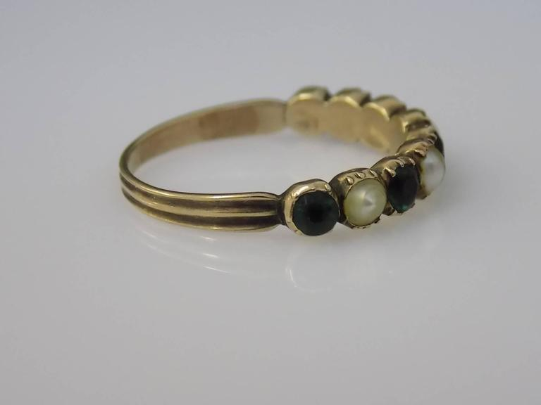 A Lovely Georgian c.1800 15 Carat Gold, Emerald colour paste and natural split Pearl ring. Slight graduated stones in close back setting. Stackable. English origin. Size S 1/2 UK, 9.75 US. Height of the face 4.2mm. Unmarked, tested 15 carat gold.