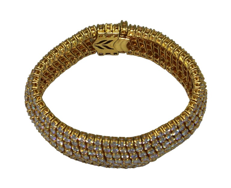 The flexible band of diamonds composed as a bracelet, circa 1970, set throughout with round diamonds weighing approximately 33.00 carats, gross weight 90.4 grams, length 6 1/2 inches, width 3/4 inch. A great value for a high carat weight and great
