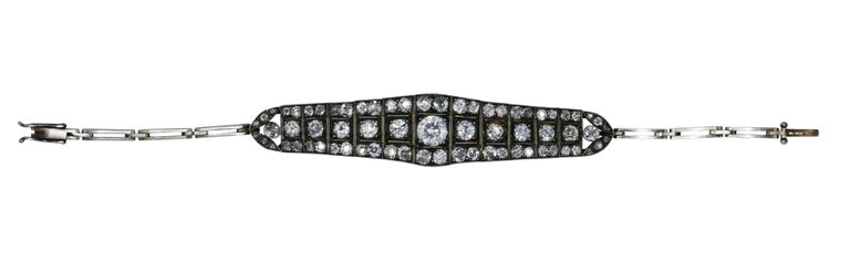 Victorian platinum-topped gold and diamond bracelet, designed as a tapered articulated plaque set throughout with diamonds weighing a total of approximately 10.00 carats, the center diamond weighing approximately 1.50 carats, gross weight 19.3