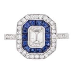 Vintage Emerald Cut Diamond and Sapphire Halo Ring, circa 1950s