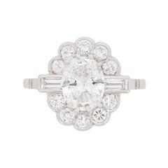 Late Deco 1.29 Carat Oval Diamond Cluster Ring, circa 1930s